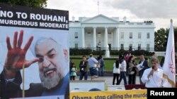 Американцы иранского происхождения протестуют у Белого дома против переговоров президента США Барака Обамы и президента Ирана Хасана Роухани. Вашингтон, 28 сентября 2013 года.