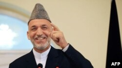 President Karzai's office has said it will accept the Independent Election Commission's decision, but notes the Afghan Constitution makes no mention of a transitional government.