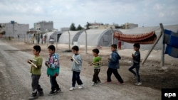 Many children have been badly affected by the crisis in Iraq and Syria. (file photo)