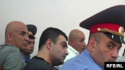 Armenia -- Gagik Matevosian (C) and other men accused of plotting to assassinate State Revenue Committee chief Gagik Khachatrian at the start of their trial, 8July 2010.