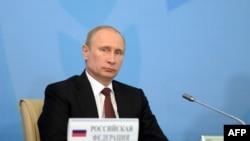 Президент России Владимир Путин на саммите ШОС. Бишкек, 13 сентября 2013 года.