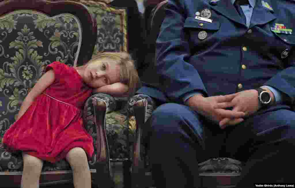 A girl pauses during a Christmas show for children of Romanian military families in Bucharest on December 21. (AP/Vadim Ghirda)