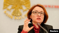 "Bank of Russia Governor Elvira Nabiullina says the Russian economy is moving toward growth in a ""patchy and unsteady"" way."