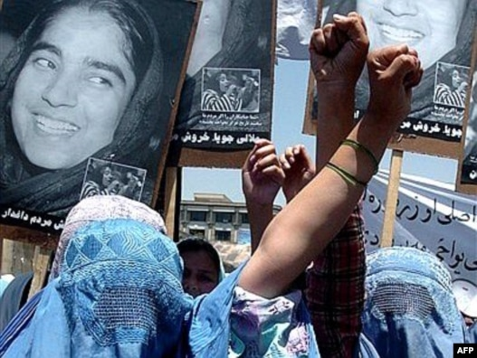 Afghan women take part in a demonstration against the national parliament's removal of outspoken female legislator Malalai Joya in May 2007.
