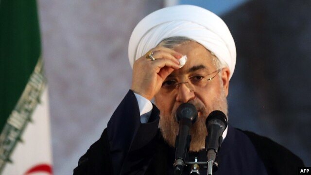 Iranian President Hassan Rohani delivers a speech on the eve of the 25th anniversary of the Islamic revolutionary leader Ayatollah Ruhollah Khomeini's death, at his mausoleum in a suburb of Tehran, on June 3.