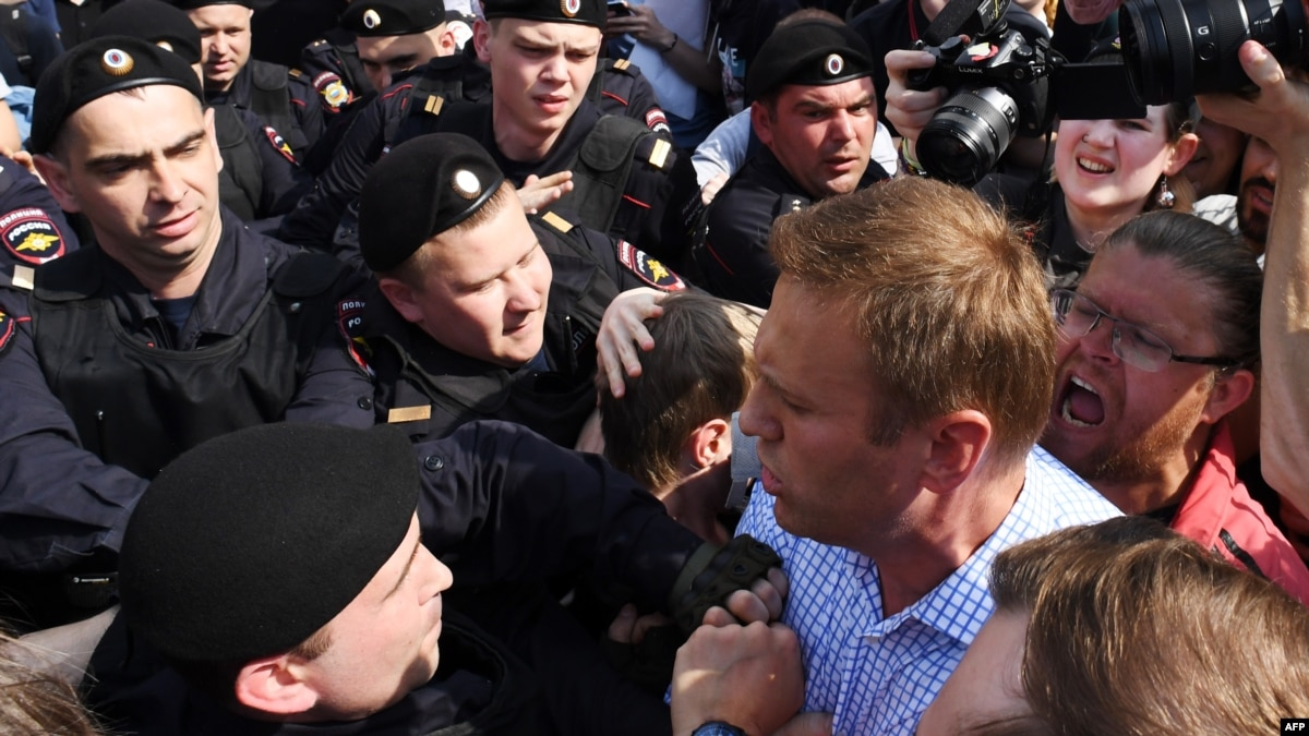Navalny Detained Amid Protests Against Putin