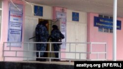 Security forces at a polling station in Zhanaozen in mid-January voting, in the wake of the previous month's deadly clashes