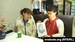 Daichi Yoshida's mother, Yoko Yoshida (left), and his brother Seyja Yoshida look at a portrait of Daichi drawn by Seyja during a prison visit.