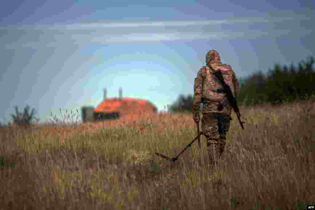 A Ukrainian serviceman checks for mines along the positions of Ukrainian forces near Seversk in the eastern Donetsk region. (AFP/Oleksandr Ratushniak)
