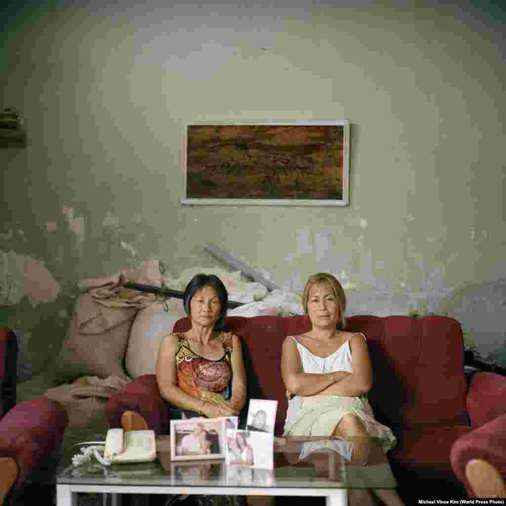 Sisters Olga and Adelina Lim Hi, two of the few Korean descendants who do not have mixed heritage. Their grandfather was Im Cheon Taek, one of the leading figures of the earliest Korean community in Cuba.  People -- First Prize, Stories (Michael Vince Kim)