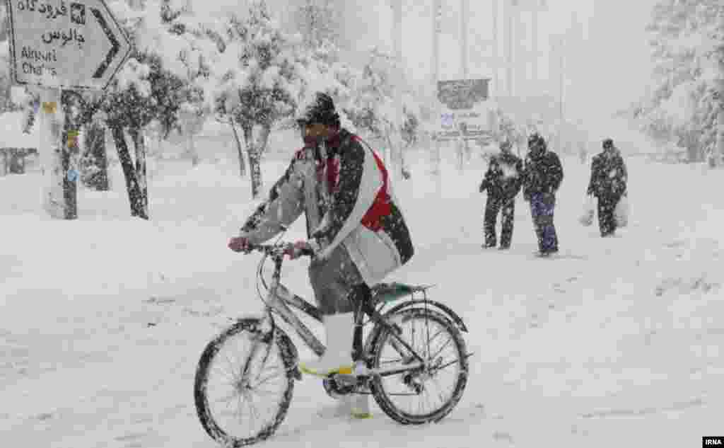 In Iran's Mazandaran Province, a bicyclist tries his luck on a snowy road.