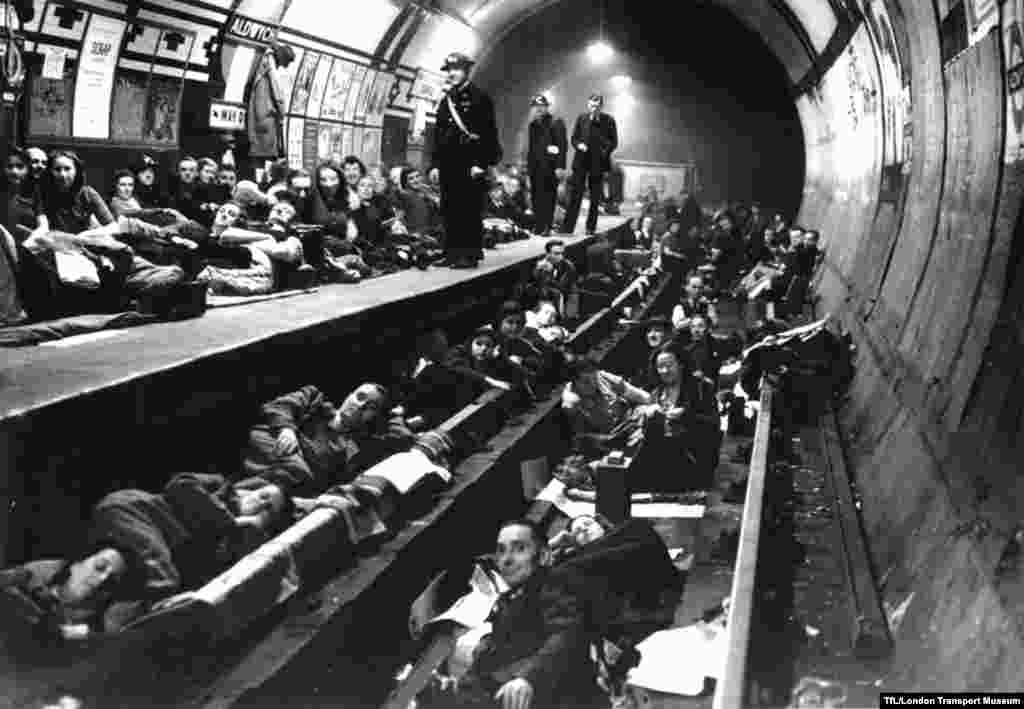 Thousands of Londoners took shelter in the Underground during the Blitz, the German aerial campaign against Britain during World War II. Here people take cover in Aldwych Station, which was also used as a storehouse for artistic and historical treasures.