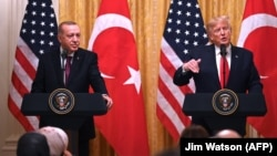 U.S. -- U.S. President Donald Trump and Turkish President Recep Tayyip Erdogan (L) take part in a joint press conference in the East Room of the White House in Washington, November 13, 2019