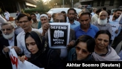 FILE: Journalists protest in Karachi Pakistan in February.