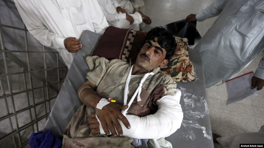 A man who was injured in twin bomb blasts in Parachinar in the Kurram tribal agency is brought to a hospital on June 24. The Kurram region has been the scene of several deadly militant attacks against its Shi'ite population in recent years.