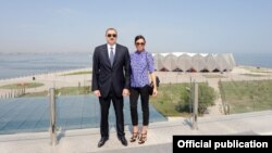 Azerbaijani President Ilham Aliyev and his wife, Mehriban, attend the opening of Baku's Crystal Hall, the venue of the Eurovision-2012 Song Contest and built by a construction company connected to the family through proxies.