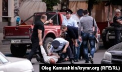 Riot police in Crimea detain a Tatar man in the Crimean capital, Simferopol. (file photo)