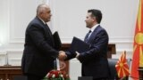 Macedonian Prime Minister Zoran Zaev (right) and his Bulgarian counterpart Boyko Borisov signed a friendship agreement in August 2017 -- but actual agreement is still a work in progress.