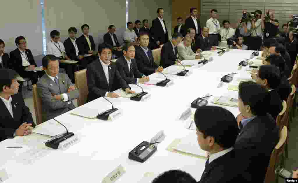 Japanese Prime Minister Shinzo Abe (third from left) speaks during a meeting with nuclear authorities on September 3.