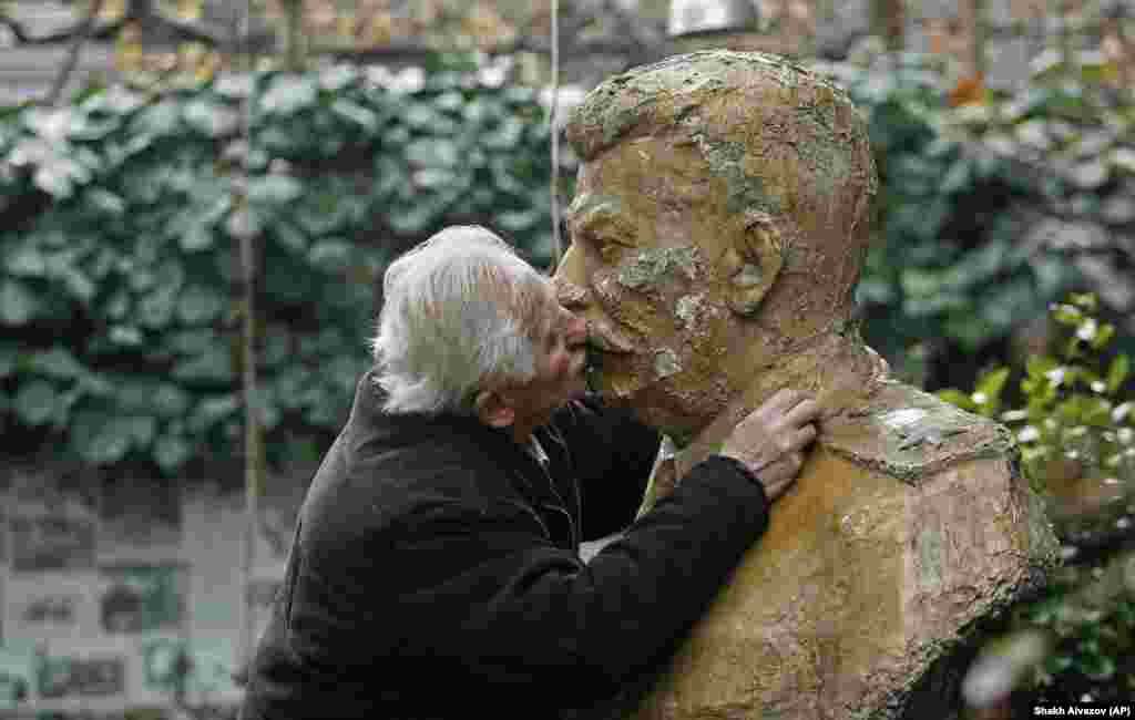 But for die-hard communists like Ushangi Davitashvili, who keeps a shrine to Stalin in his garden in Tbilisi, the lip-smacking tradition continues, even if those lips have long-since turned to stone.