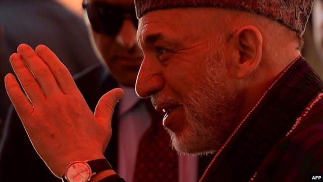 Afghan President Hamid Karzai at a charitable housing project event in Kabul on May 16