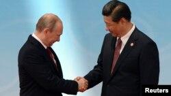 Президент Росії Володимир Путін і його китайський колега Сі Цзіньпін, Шанхай, 21 травня 2014 року