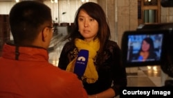 Kyrgyzstan--Documentary filmmaker and RFE/RL contributor Janyl Jusupjan gives an interview to local TV station in Bishkek.
