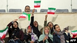 IRAN -- Iranian women cheer during the friendly football match between Iran and Bolivia at the Azadi Stadium in Tehran, October 16, 2018