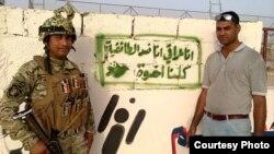 شعار ينبذ الطائفية على جدار ضمن حملة سابقة في بغداد