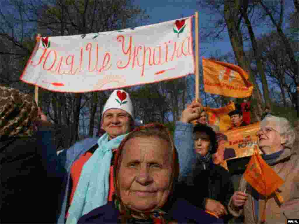 "Orange Vs. Blue - Women at an oppostion rally on Kyiv's European Square on April 11 try to get opposition leader Yuliya Tymoshenko's attention with a banner reading ""Yuliya! This is Ukraine."" (photo: RFE/RL)"