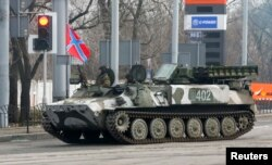 Pro-Russian rebels drive a self-propelled antiaircraft system in Donetsk on February 3.