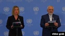 Глава внешнеполитического ведомства ЕС Федерика Могерини (слева) и министр иностранных дел Ирана Джавад Зариф. Вена, 16 января 2016 года.