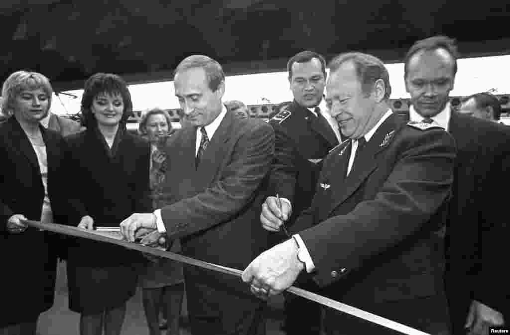 Vladimir Putin, as first deputy mayor, attends a ceremony to open a new booking office at the Moskovsky Railway Station in St. Petersburg on May 12, 1996.