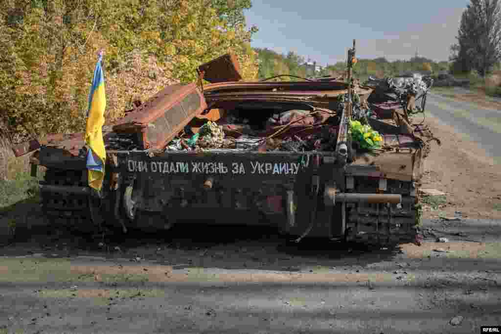 "A destroyed Ukrainian tank on the road leading to the war-torn town of Pisky. The writing on the tank reads: ""They gave their lives for Ukraine."" Pisky was once a wealthy suburb of Donetsk but has been completely devastated by the war."