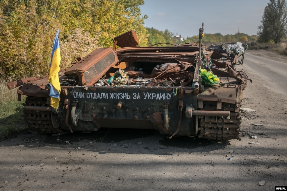 "A destroyed Ukrainian tank on the road leading to the war-torn town of Pisky. The writing on the tank reads ""they gave their lives for Ukraine."" Pisky was once a wealthy suburb of Donetsk, but has been completely devastated by the war."