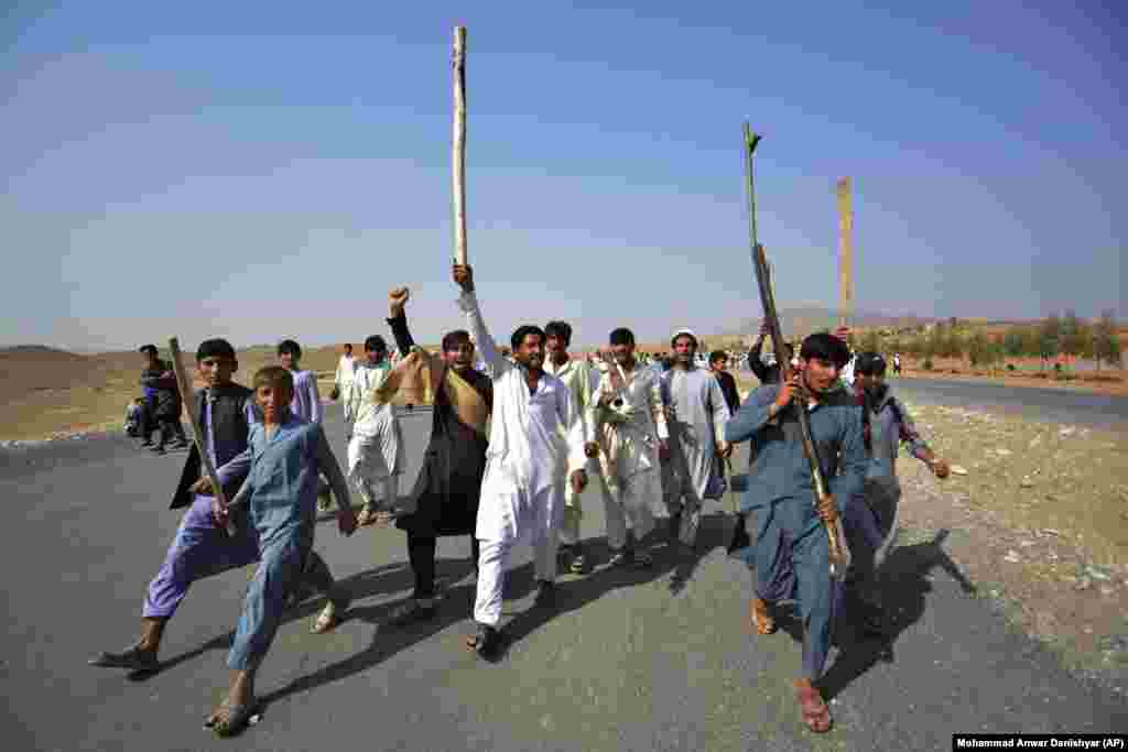 Afghans shout slogans against the government after a military operation left at least 11 civilians dead in the Rodat district of Nangarhar Province on October 24. (AP/Mohammad Anwar Danishyar)