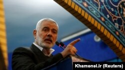 Hamas leader Ismail Haniya speaks during the funeral prayer over the coffins of Iranian Major-General Qassem Soleimani, head of the Qods Force, who was killed in an air strike at Baghdad airport, in Tehran. January 6, 2020
