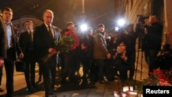 Sankt Petersburg, președintele rus Vladimir Putin depune flori în memria victimelor, 3 aprilie 2017