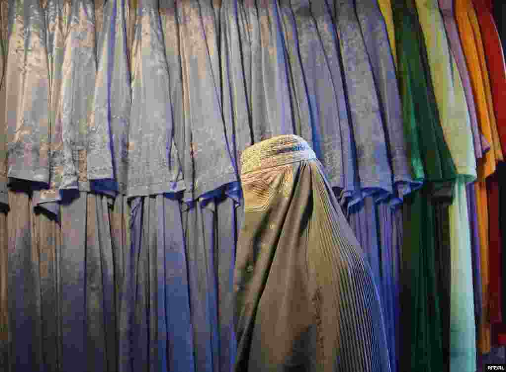 An Afghan woman browses at the burqa market in Kabul. - Photo by RFE/RL
