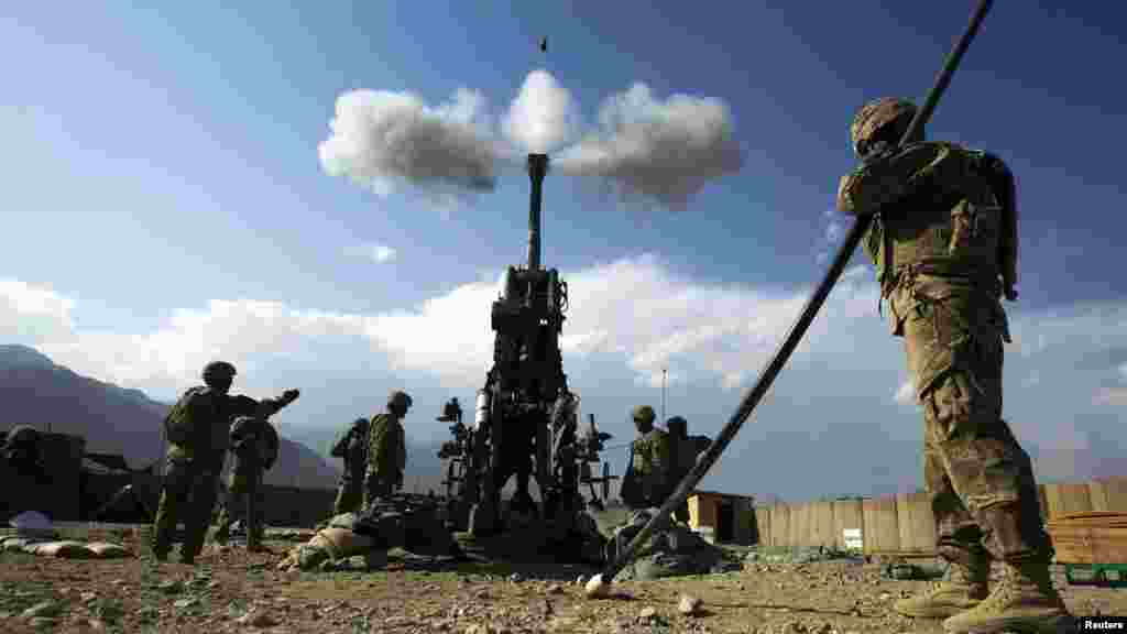 U.S. soldiers fire a 155 mm Howitzer towards insurgent positions at FOB Joyce in Afghanistan's Kunar Province. (Reuters/Lucas Jackson)