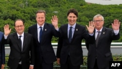 U.K Prime Minister David Cameron (second left) with French President Francois Hollande (left), Canadian Prime Minister Justin Trudeau, and EC Presideent Jean-Claude Juncker at the G7 summit in Japan.