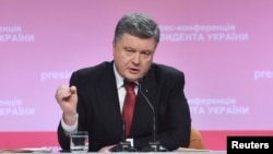 Ukrainian President Petro Poroshenko speaks during a news conference in Kyiv on December 29.