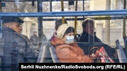 Ukrainians ride public transport in Kyiv, where the government closed the subway on March 17.