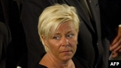 The leader of Norway's Progress Party, Siv Jensen, attends a Mass for victims of the July 22 government office bombing and shooting spree at a youth camp, at the Domkirken Church in Oslo on July 24.