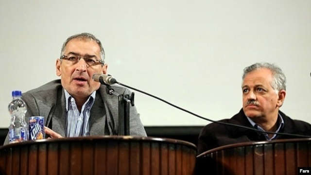 Professor Sadegh Zibakalam (left) speaks as former legislator Ahmad Shirzad looks on at a conference about Iran's nuclear program at Tehran University on December 17.