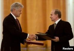 Президент США Білл Клінтон і президент Росії Володимир Путін