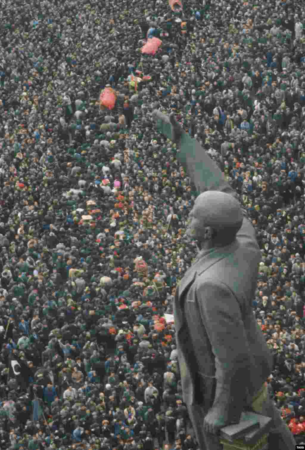 Another scene of mass crowds at a funeral - a statue of Lenin looks on, but the Soviet Union's days are numbered.