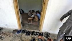 Students recite Koranic verses at an Islamic madrasah on May 10, near Abbottabad, Pakistan, where Osama bin Laden was killed on May 1-2.