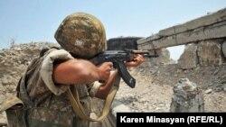 Nagorno-Karabakh -- An Armenian soldier on frontline duty near Mataghis, 20Jul2012