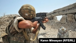 Nagorno-Karabakh -- An Armenian soldier on frontline duty near Mataghis, 20Jul2012